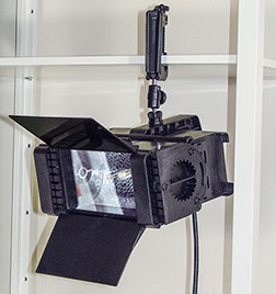 Mobile video lighting unit attached to a horizontal metal bar.