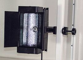Mobile video lighting unit attached to a vertical metal bar.